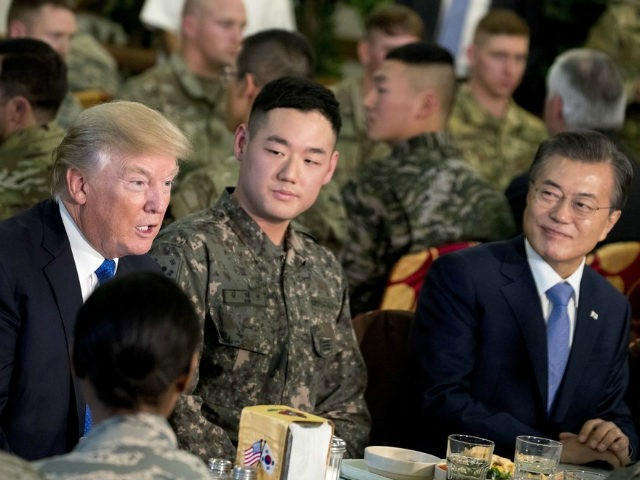U.S. President Donald Trump and South Korean President Moon Jae-in, right, have lunch with U.S. and South Korean troops at Camp Humphreys in Pyeongtaek, South Korea, Tuesday, Nov. 7, 2017. Trump is on a five-country trip through Asia traveling to Japan, South Korea, China, Vietnam and the Philippines. (AP Photo/Andrew …