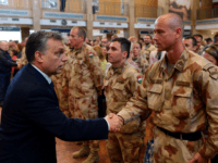 Hungarian Prime Minister Viktor Orban, left, welcomes Hungarian army soldiers as the last unit of the Hungarian Provincial Reconstruction Team deployed in Afghanistan returns home at Budapest Liszt Ferenc International Airport in Budapest, Hungary, Thursday, March 28, 2013 after the Hungarian PRT of NATO forces finished its mission in Afghanistan. …