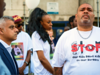 LONDON, ENGLAND - MAY 08: London Mayor Sadiq Khan (L) looks on as a man wears an anti-violence shirt following the murder of teenager Rhyhiem Ainsworth Barton, ahead of a solidarity march on May 8, 2018 in south London, England. The 17 year old boy was shot during a weekend …