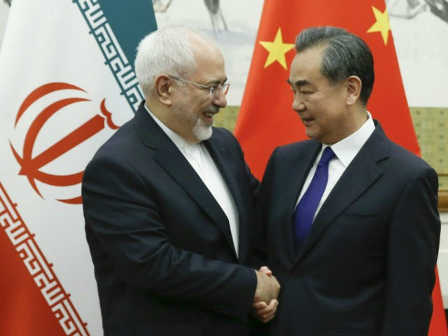 Chinese State Councillor and Foreign Minister Wang Yi meets Iranian Foreign Minister Mohammad Javad Zarif at Diaoyutai state guesthouse on May 13, 2018 in Beijing, China. (Photo by Thomas Peter - Pool / Getty Images)