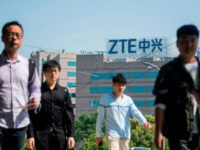 The ZTE logo is seen on an office building in Shanghai on May 3, 2018. - Senior US officials arrive in Beijing for trade talks with China, as both sides dampen expectations for a quick resolution to the heated dispute between the world's two largest economies. (Photo by Johannes EISELE …