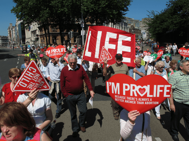 Anti-abortion protesters holding placards walk through Ireland's capital, Dublin, in an anti-abortion protest Saturday, July 6, 2013. More than 35,000 activists marched to the parliament building to oppose Irish government plans to enact a bill legalizing terminations for women in life-threatening pregnancies. The Protection of Life During Pregnancy Bill is …
