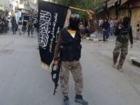 Islamic fighters from the al-Qaida group in the Levant, Al-Nusra Front, wave their movement's flag as they parade at the Yarmuk Palestinian refugee camp, south of Damascus, to denounce Israels military offensive on the Gaza Strip, on July 28, 2014. Israeli shells struck a UN school in Gaza early today, …