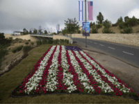 Flowers decorated as an American flag are seen on a road leading to the US Embassy compound ahead the official opening in Jerusalem, Sunday, May 13, 2018. On Monday, the United States moves its embassy in Israel from Tel Aviv to Jerusalem, the holy city at the explosive core of …