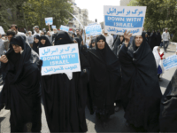 "Iranian women hold anti-Israeli placards at a protest after Friday prayer service in Tehran, Iran, Friday, Sept. 18, 2015. Hundreds of worshipers staged an anti-Israeli protest for its response to Palestinians protest against unusual numbers of Jewish visitors at Al-Aqsa mosque compound in recent days. Chanting ""Death to Israel"" and …"