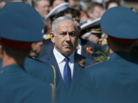 Israeli Prime Minister Benjamin Netanyahu attends a wreath-laying ceremony at the Tomb of the Unknown Soldier after the Victory Parade marking the 73th anniversary of the defeat of the Nazis in World War II, in Moscow, Russia, Wednesday, May 9, 2018. (AP Photo/Alexander Zemlianichenko)