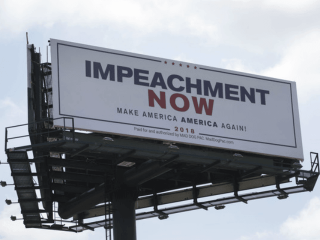 WEST PALM BEACH, FL - MARCH 19: A billboard reading: 'Impeachment Now Make America America Again!' calling for President Donald Trump's impeachment is seen along a street leading to Mar-A-Lago on March 19, 2018 in West Palm Beach, Florida. The sign was installed by The Mad Dog PAC and is …