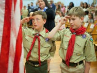 WILMINGTON, NC - APRIL 9: Boy Scouts at Forest Hills Elementary School say the Pledge of Allegiance as they host the Azalea Queen and official party during the Azalea Festival, on April 9, 2015 in Wilmington, North Carolina. For the past 20 years, each year, a school is picked for …