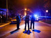 Police work the scene where two people were shot near the intersection of 60th and Maplewood Avenue Tuesday April 24, 2018 in Chicago. (Armando L. Sanchez/Chicago Tribune/TNS via Getty Images)
