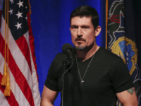 "Former Army Ranger, Kris ""Tonto"" Paronto speaks to a gathering, about his experience in the 2012 Benghazi attacks, during a campaign rally for Republican presidential candidate Donald Trump Monday, Nov. 7, 2016, in Scranton, Pa. (AP Photo/Mel Evans)"