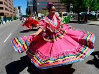 DENVER, CO - MAY 6: Dancers from the Colorado Mestizo Dancers perform near Lincoln and Colfax Ave during the 30th annual Cinco de Mayo 'Celebrate Culture Festival parade May 6, 2017 in Denver, Colorado. Over 400,000 festival goers are expected to attend the festival May 6th and May 7th at …