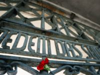 A flower sticks next to the writing 'Jedem das Seine' (literally: To each his own) at the gate of the Buchenwald concentration camp in Weimar, where ceremonies were held 15 April 2007 to mark the 62nd anniversary of the camp's liberation. US army units liberated 21,000 survivors here on 11 …