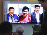 In this May 3, 2018, photo, people watch a TV news report on screen showing portraits of three Americans, Kim Dong Chul, left, Tony Kim and Kim Hak Song, right, detained in the North Korea, at the Seoul Railway Station in Seoul, South Korea. (Ahn Young-joon / AP)