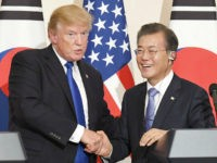 U.S. President Donald Trump (L) and his South Korean counterpart Moon Jae In shake hands after a joint press conference in Seoul on Nov. 7, 2017. Trump said there has been 'a lot of progress' in dealing with North Korea's nuclear and missile threats, thanks to his country's 'unparalleled' military …