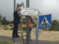 In this photo released by the Jerusalem Municipality, Jerusalem Mayor Nir Barkat poses with a new road sign to the new U.S. Embassy in Jerusalem, Monday, May 7, 2018. Jerusalem's city hall says it has put up road signs pointing to the new U.S. Embassy, which is set to move …