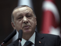 "Turkish President Recep Tayyip Erdogan addresses the members of his ruling party at the parliament in Ankara, Turkey, Tuesday, March 20, 2018. Erdogan has called on the United States to ""show respect"" and ""walk with"" its NATO ally, in new criticism of Washington over its engagement with Syrian Kurdish militia. …"