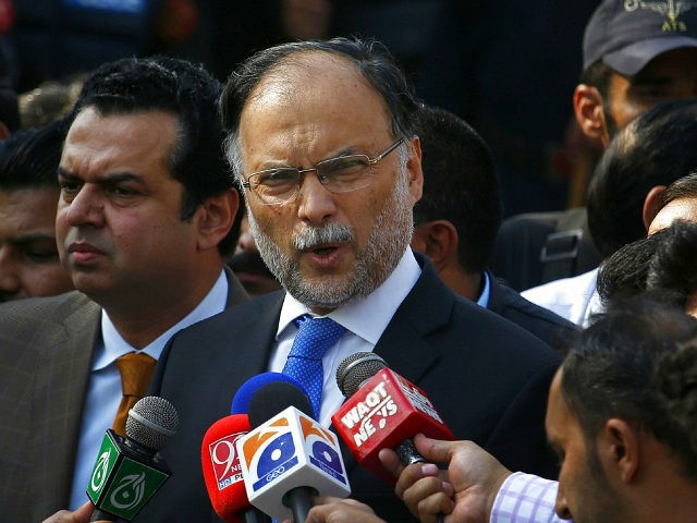 FILE - In this Oct. 2, 2017 file photo, Pakistani Interior Minister Ahsan Iqbal talks to journalists outside the accountability court, in Islamabad, Pakistan. Pakistani officials said Sunday, May 6, 2018, that a gunman opened fire on Iqbal after a public meeting, wounding him in shoulder. (AP Photo/Anjum Naveed, File)