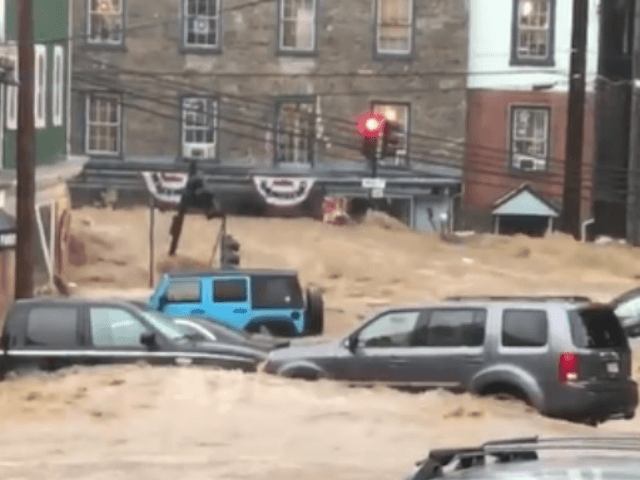 Flash flood surges through Ellicott City, Maryland