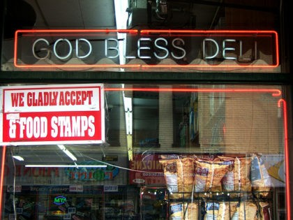 We Accept Food Stamps sign in the window of God Bless Deli