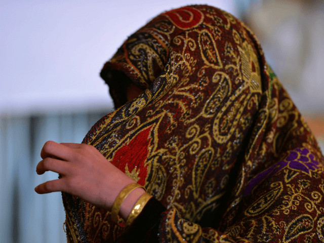 To go with 'Pakistan-unrest-women-marriages-Children-social, FEATURE' by Khurram SHAHZAD In this photograph taken on December 12, 2013 young Pakistani girl Saneeda, who escaped a forced marriage under a local custom of Swara, speaks with an AFP journalist in the Madyan valley of Swat, in the country's northwest. One sunny afternoon as …