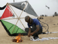 Palestinians prepare an incendiary device attached to a kite before trying to fly it over the border fence with Israel, on the eastern outskirts of Jabalia, on May 4, 2018. - Hundreds of Palestinians gathered on the Gaza border Friday for the sixth week of protests in which dozens have …