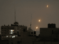 Smoke rises following an Israeli strikes on Gaza City, early Wednesday, May 30, 2018. Palestinian militants bombarded southern Israel with dozens of rockets and mortar shells while Israeli warplanes struck targets throughout the Gaza Strip in the largest flare-up of violence between the sides since a 2014 war. (AP Photo/Hatem …