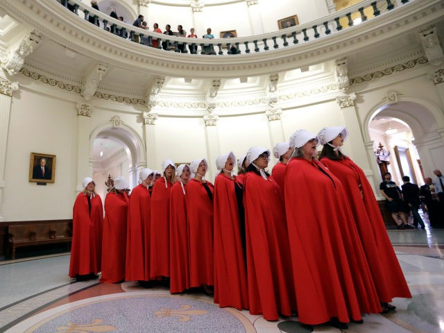 "Activists dressed as characters from ""The Handmaid's Tale"" chant in the Texas Capitol Rotunda as they protest SB8, a bill that would require health care facilities, including hospitals and abortion clinics, such as Planned Parenthood, to bury or cremate any fetal remains whether from abortion, miscarriage or stillbirth, and they would be banned from donating aborted fetal tissue to medical researchers, Tuesday, May 23, 2017, in Austin. (AP Photo/Eric Gay)"