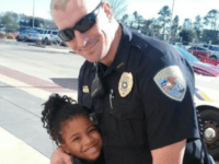 Adorable little girl travels around the country giving hugs to police officers to show her love for law enforcement