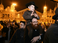 Hungarians from the Jewish community take part in a ceremony during which a giant Menorah is lit to mark the start of Hanukkah celebrations on December 12, 2017 at the Western square in the center of Budapest Hanukkah commemorates the re-dedication of the holy temple in Jerusalem after the Jews' …