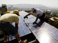 FILE - In this March 23, 2010, file photo, installers from California Green Design install solar electrical panels on the roof of a home in Glendale, Calif. The Obama administration is boosting the development of solar and wind energy on public lands. A final rule announced by the Interior Department …