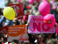 People hold up placards during a 'Stand up for Life' rally calling for a 'no' vote in the upcoming referendum, to preserve the eighth amendment of the Irish constitution, a subsection that effectively outlaws abortion in most cases, in Dublin on May 12, 2018. - Ireland will hold a referendum …