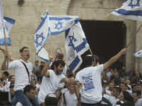 Israelis wave their national flags during a march outside Damascus Gate on May 13, 2018 in Jerusalem, Israel. Israel mark Jerusalem Day celebrations the 51th anniversary of its capture of Arab east Jerusalem in the Six Day War of 1967. One day before US will move the Embassy to Jerusalem. …