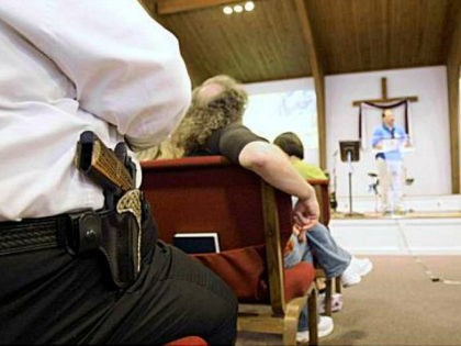 Cliff Meadows wears his firearm as he listens to pastor Ken Pagano during a service at the New Bethel Church where people were invited to bring their own firearms to the sanctuary in Louisville, Ky., Saturday, June 27, 2009. (AP Photo/Ed Reinke, Pool)