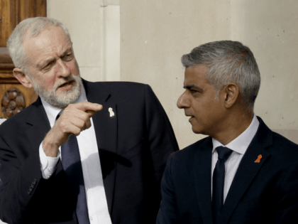 Britain's opposition Labour party leader Jeremy Corbyn, left, talks with London mayor Sadiq Khan, as they wait to pose for a group photograph after the Memorial Service to commemorate the 25th anniversary of the murder of black teenager Stephen Lawrence at St Martin-in-the-Fields church in London, Monday, April 23, 2018. …