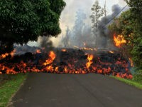 PAHOA, HI - MAY 6: In this handout photo provided by the U.S. Geological Survey, a lava flow moves on Makamae Street after the eruption of Hawaii's Kilauea volcano on May 6, 2018 in the Leilani Estates subdivision near Pahoa, Hawaii. The governor of Hawaii has declared a local state …