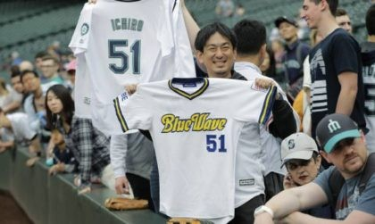 Fans hold Ichiro Suzuki jerseys from the Seattle Mariners and Orix BlueWave before a baseball game between the Mariners and the Oakland Athletics, Thursday, May 3, 2018, in Seattle. Suzuki was released Thursday by the Mariners and is shifting into a front office role with the team. (AP Photo/Ted S. …