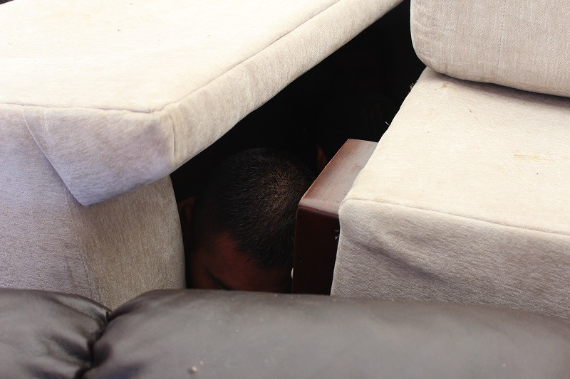 A Mexican migrant found hiding in a load of furniture packed in back of a box truck. (Photo: U.S. Border Patrol/Laredo Sector)