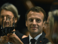 President of France, Emmanuel Macron, center, holds up his glass during a dinner hosted by Australian Prime Minister, Malcolm Turnbull, at the Sydney Opera House in Sydney, Tuesday, May 1, 2018. (Mick Tsikas/Pool Photo via AP)