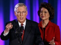 FILE - In this Nov. 4, 2014 file phot, Senate Minority Leader Mitch McConnell of Ky., joined by his wife, former Labor Secretary Elaine Chao, celebrates with his supporters at an election night party in Louisville, Ky. President Barack Obama has the upper hand in the fierce struggle over immigration …