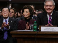 WASHINGTON, DC - JANUARY 11: Elaine Chao (C) listens to her husband Senate Majority Leader Mitch McConnell (R-KY) (R) during her confirmation hearing to be the next U.S. secretary of transportation before the Senate Commerce, Science and Transportation Committee in the Dirksen Senate Office Building on Capitol Hill January 11, …