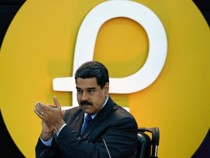 Venezuela's President Nicolas Maduro gestures during a press conference to launch to the market a new oil-backed cryptocurrency called 'Petro', at the Miraflores Presidential Palace in Caracas, on February 20, 2018. Venezuela formally launched its new oil-backed cryptocurrency on Tuesday in an unconventional bid to haul itself out of a …