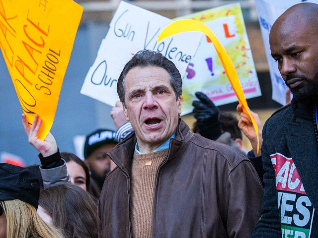 Andrew Cuomo, governor of New York, center, gathers with demonstrators near Central Park during the March For Our Lives in New York, U.S., on March 24, 2018. Thousands of high school students and other gun-control advocates gathered in Washington and across the U.S. Saturday to demand tougher firearms restrictions from …