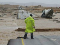 An Omani civil defence staff visits a road which has been cut by the flood water after Cyclone Merkunu in Salalah, Oman, Saturday, May 26, 2018. Cyclone Merkunu blew into the Arabian Peninsula on Saturday, drenching arid Oman and Yemen with rain, cutting off power lines and leaving at least …