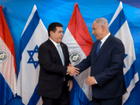 Israeli Prime Minister Benjamin Netanyahu (R) shakes hands with Paraguayan President Horacio Cartes during their meeting at the Prime Minister's office in Jerusalem on May 21, 2018. - Paraguay followed the US and Guatemala to inaugurate its new embassy in Jerusalem on May 21. (Photo by Sebastian Scheiner / POOL …