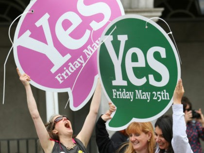 "People from the ""Yes"" campaign react as the results of the votes begin to come in, after the Irish referendum on the 8th Amendment of the Irish Constitution at Dublin Castle, in Dublin, Ireland, Saturday May 26, 2018. The first official results for Ireland's landmark abortion referendum have begun to …"