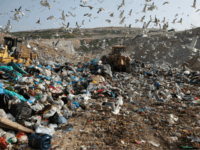 In this Wednesday, Feb. 2, 2018 file photo, earthmovers push mountains of garbage as seagulls fly over the country's largest landfill at Fyli on the outskirts of Athens. The British government is planning a consultation about a possible bill to end the use of plastic straws, drink stirrers and cotton …