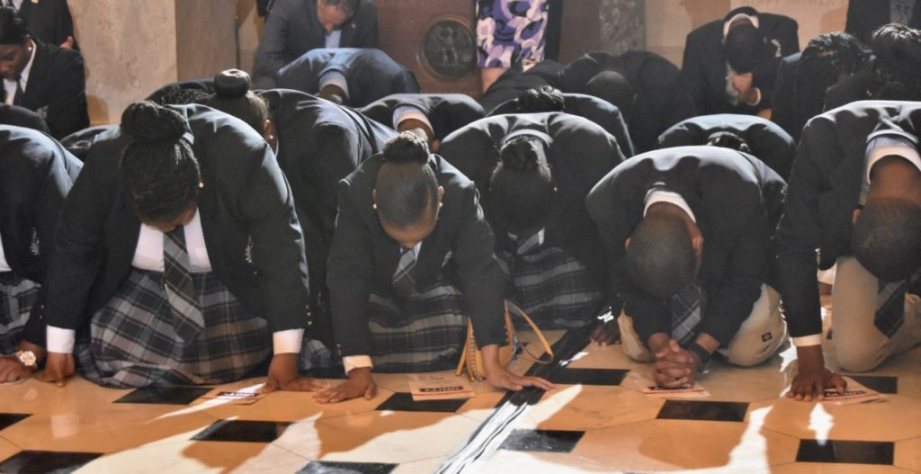 People dropped to their knees to prayer at the National Day of Prayer on Thursday in Washington, DC. (Penny Starr/Breitbart News)