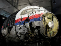 FILE - In this Tuesday, Oct. 13, 2015 file photo, the reconstructed wreckage of Malaysia Airlines Flight MH17 is put on display during a press conference in Gilze-Rijen, central Netherlands. Malaysia Airlines Flight 17 broke up high over Eastern Ukraine killing all 298 people on board. Any suspects in the …