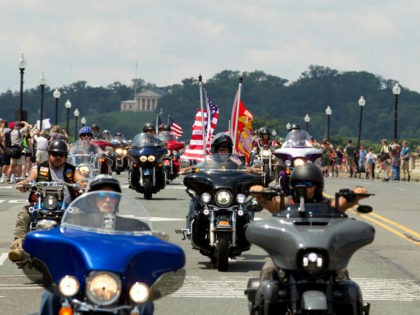 Participants in the Rolling Thunder motorcycle rally ride past Arlington Memorial Bridge, during the annual Rolling Thunder parade, ahead of Memorial Day on Sunday, May 27, 2018, in Washington. (AP Photo/Jose Luis Magana)