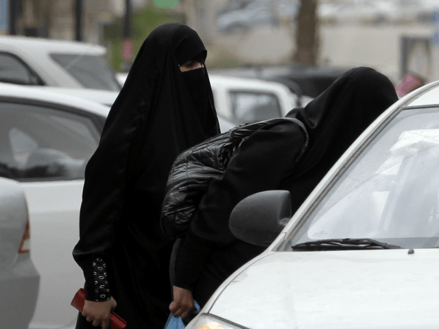 Saudi women board a taxi in Riyadh, Saudi Arabia, Tuesday, May 24, 2011. A Saudi woman was arrested for a second time for driving her car in what women's activists said Monday was a move by the rulers of the ultraconservative kingdom to suppress an Internet campaign encouraging women to …